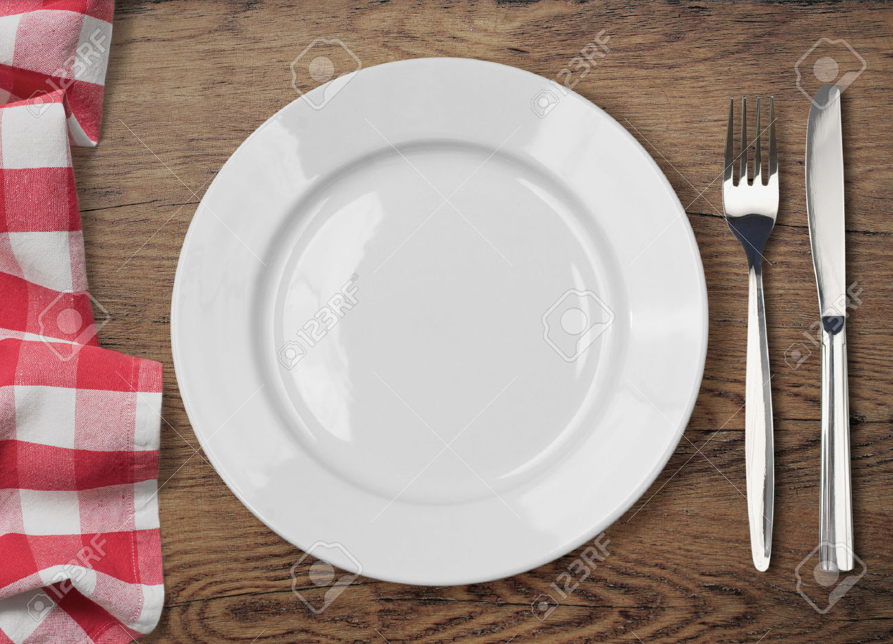 37935649-dinner-table-with-dinning-plate-fork-and-knife-top-view-Stock-Photo