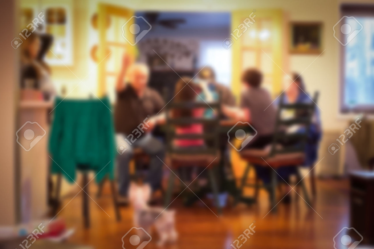 41785891-Blur-style-of-typical-American-family-dinner-in-kitchen-scene-Stock-Photo