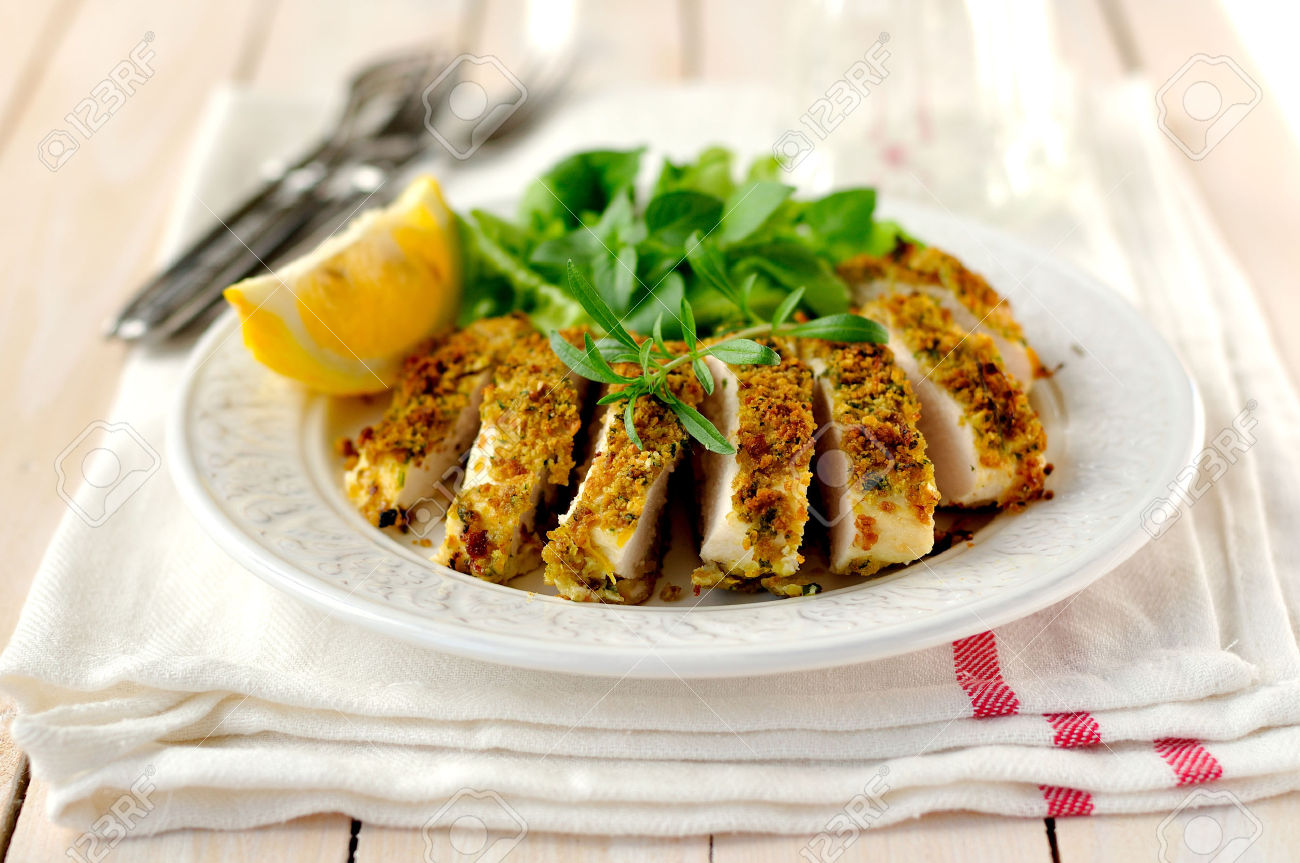48299885-Sliced-lemon-herb-crusted-chicken-breast-Stock-Photo