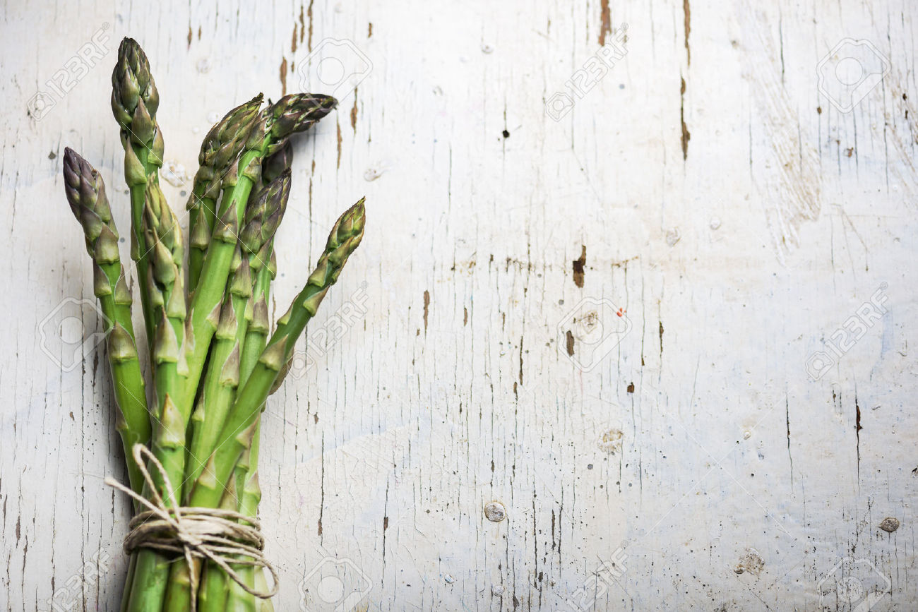 57827634-Fresh-green-asparagus-on-rustic-white-table-Stock-Photo-vegetable