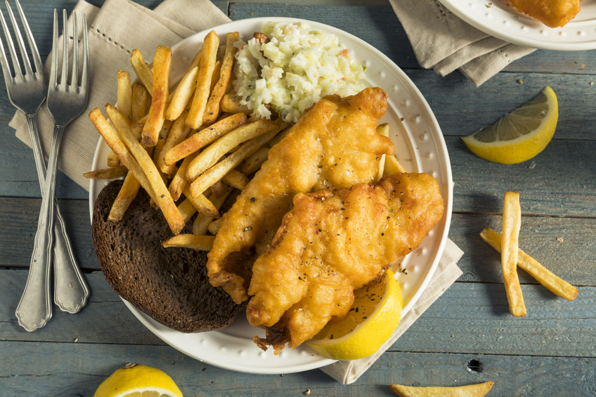 85868266 – homemade beer battered fish fry with coleslaw and chips