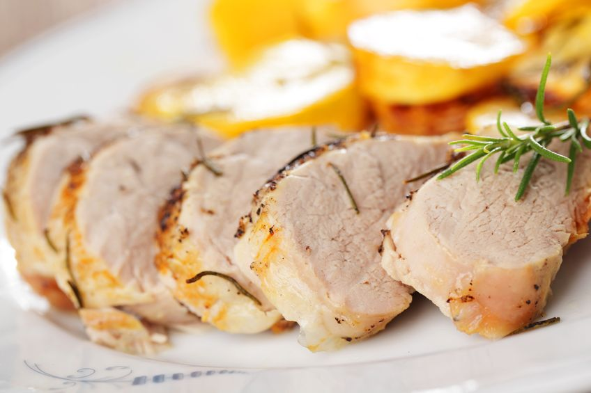 8653343 – pork tenderloin with baked turnip and rosemary on white plate